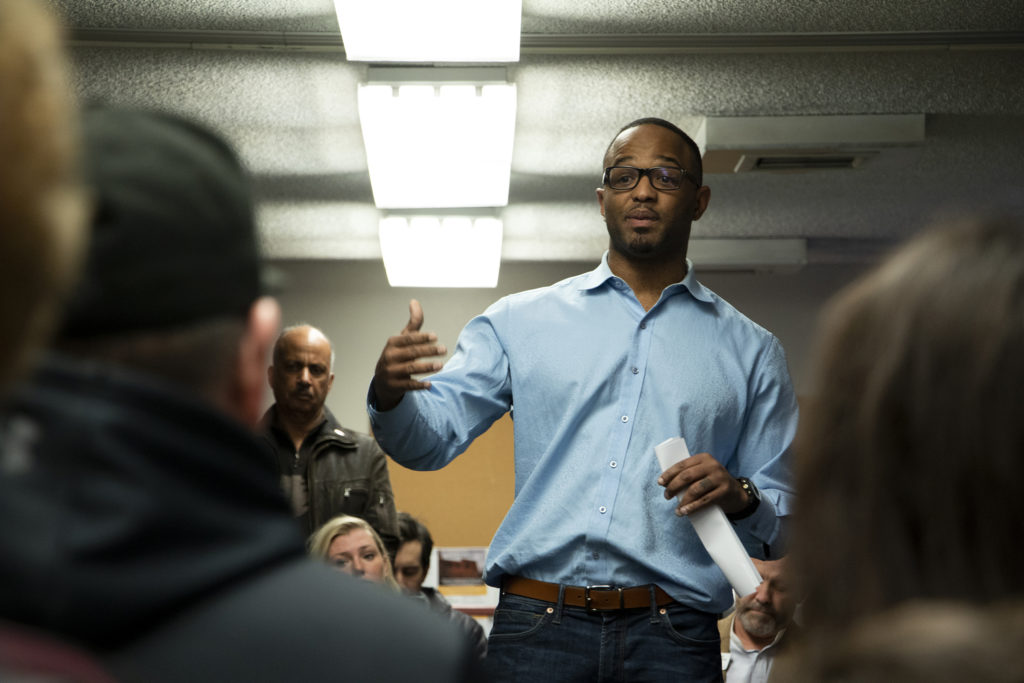 City Councilman Albus Brooks opens a meeting at the Globeville rec center about the fate of the Beloved Community tiny home village, Feb. 15, 2019. (Kevin J. Beaty/Denverite)