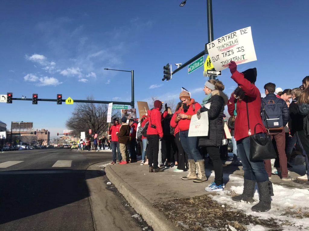 Teachers and supporters strike outside East High School in Denver on Monday, Februrary 11, 2019. (Esteban L. Hernandez/Denverite)