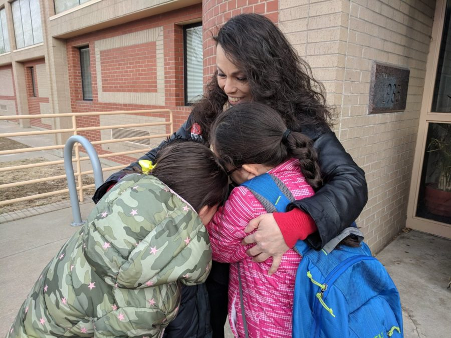 Lupe Lopez-Montoya greets students at Columbian Elementary School on Thursday after Denver's three-day teacher strike. (Eric Gorski/Chalkbeat)