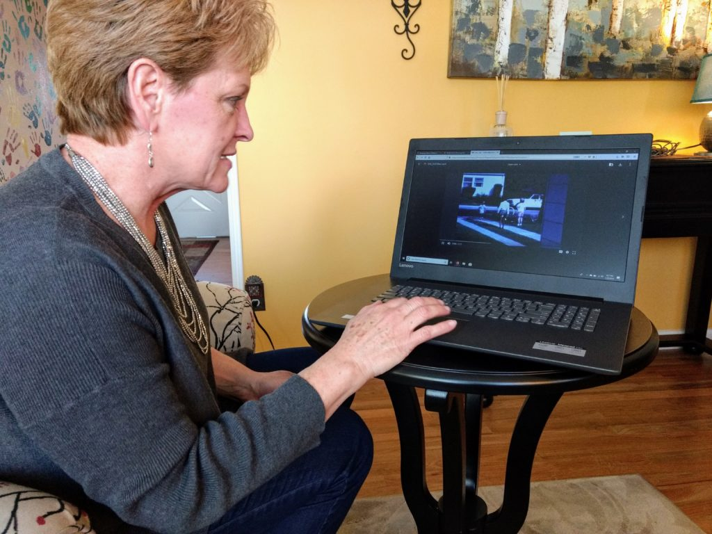 Florence Sebern views a home movie on her computer. (Donna Bryson/Denverite)