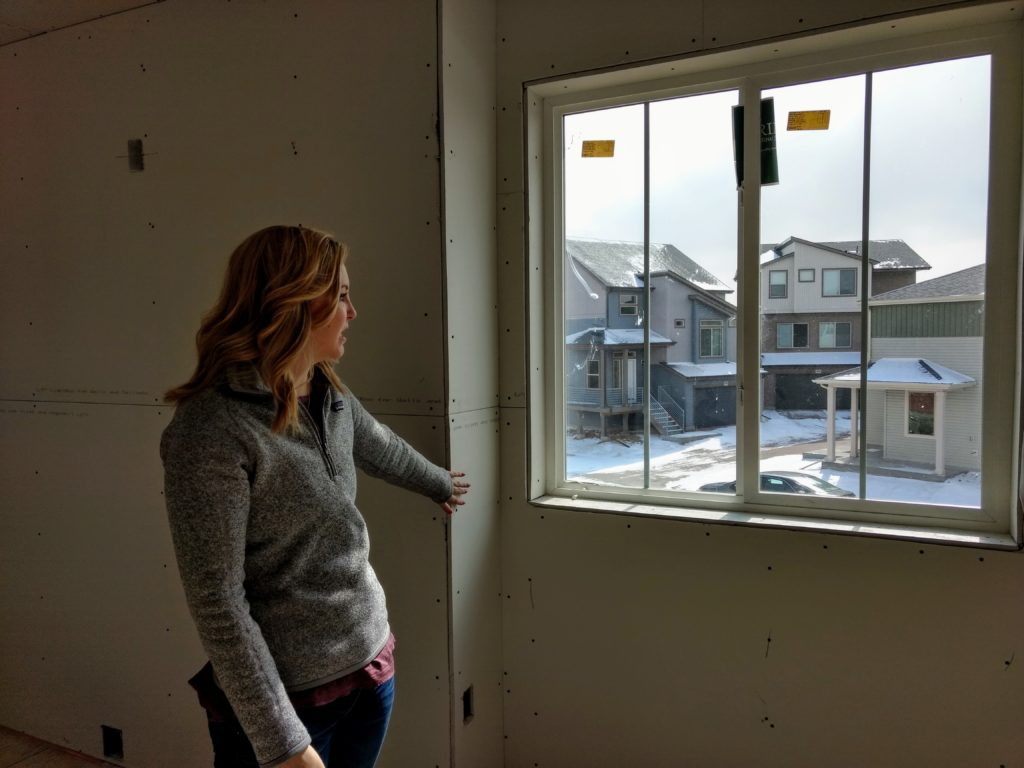 Corrie Sahling on Feb. 18 in her soon-to-be-completed American Dream home. (Donna Bryson/Denverite)