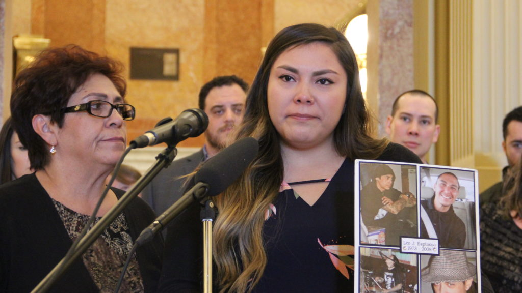 Shauna Alvillar holds a photographer of her late brother, Loe John Espinosa, next to her mother Helen Alvillar during a press conference calling for support of supervised use sites on Monday, Feb. 4, 2019, at the Capitol. (Esteban L. Hernandez/Denverite)
