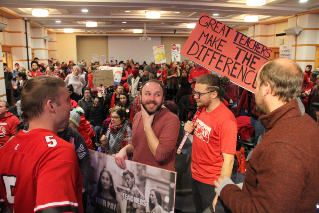 Supporters of the Denver teacher strike gather inside a conference room at Denver Central Library as the teacher's union and the school district begin negotiations on Tuesday, Feb. 12, 2019, in Denver. (Esteban L. Hernandez/Denverite)