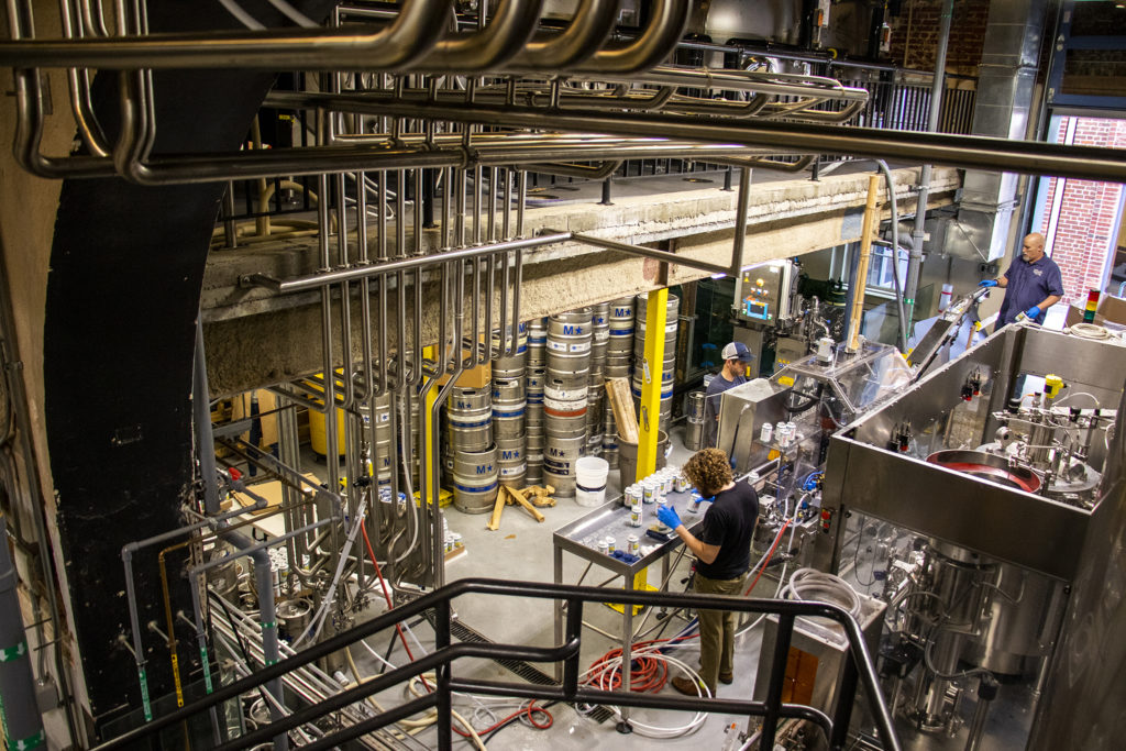 A canning operation in the works at Tivoli Brewing Co.'s historic home on the Auraria Campus, March 1, 2019. (Kevin J. Beaty/Denverite)