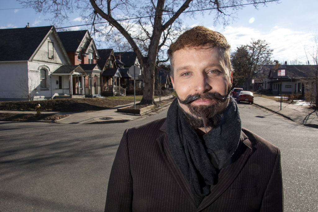 City Council At-Large candidate Johnny Hayes poses for a portrait near his home in Baker, March 19, 2019. (Kevin J. Beaty/Denverite)