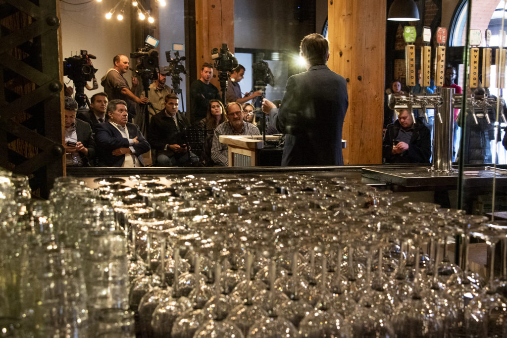 Former Governor John Hickenlooper speaks to press about his recently announced run for president at Wynkoop Brewing Co., March. 6, 2019. (Kevin J. Beaty/Denverite)