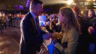 Former Governor John Hickenlooper greets Sami Helgeson after a presidential campaign rally at Civic Center Park, March 7, 2019. (Kevin J. Beaty/Denverite)