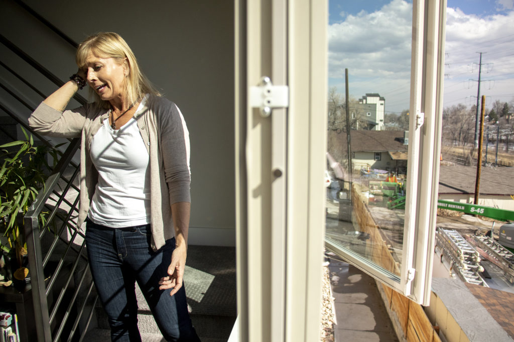 Rhonda Kelly shows a reporter faulty windows in her West Colfax condo, March 7, 2019. (Kevin J. Beaty/Denverite)