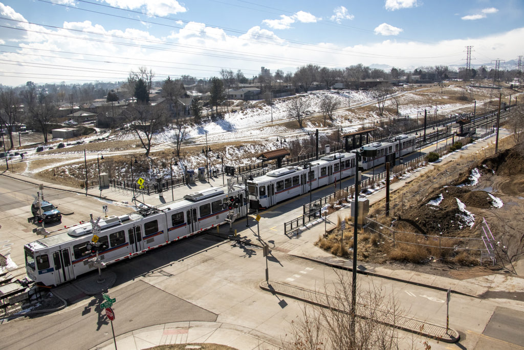 An RTD train and Lakewood/Dry Gulch Park seen from Rhonda Kelly's condo complex in Denver's West Colfax neighborhood, March 7, 2019. (Kevin J. Beaty/Denverite)