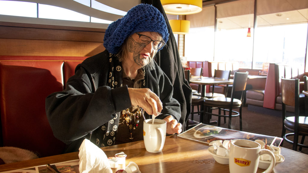Ruth eats breakfast at her favorite place: Denny's at 17th and Federal in the West Colfax neighborhood, March 9, 2019. (Kevin J. Beaty/Denverite)