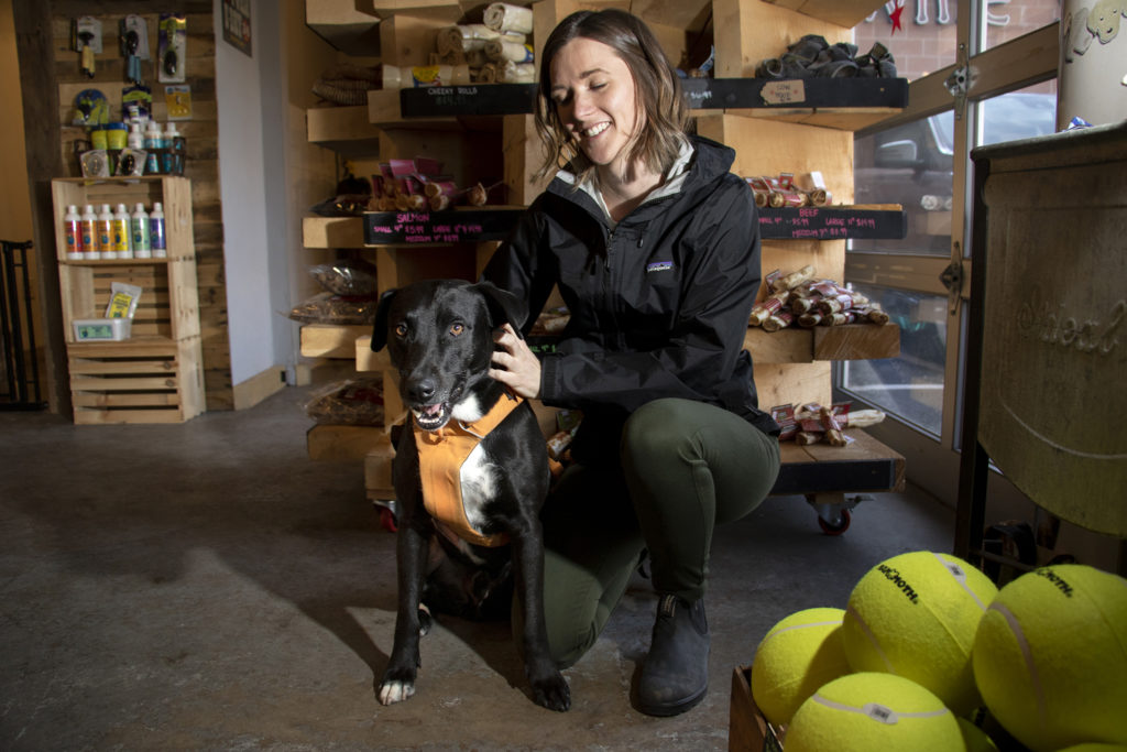 Samwise and his human, Sarah Gray, pose for a portrait in his favorite place: Luke & Company Fine Pet Supply & Outfitter on Broadway in Denver's Speer neighborhood, March 9, 2019. (Kevin J. Beaty/Denverite)