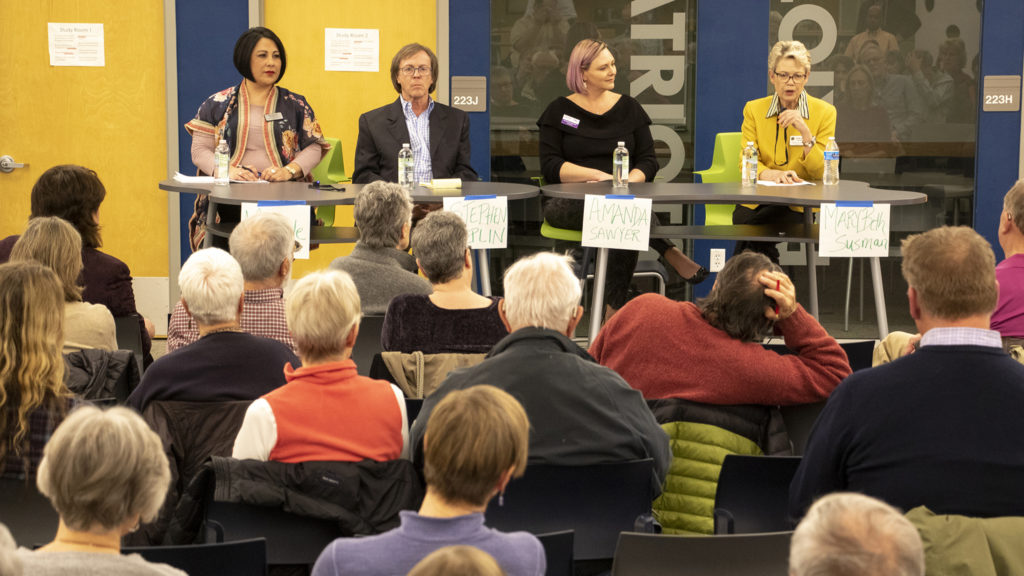City Council District 5 candidates Michele Fry (left to right), Stephen Replin and Amanda Sawyer and Councilwoman Mary Beth Susman sit for an election forum for City Council District 5. George Washington High School, March 12, 2019. (Kevin J. Beaty/Denverite)