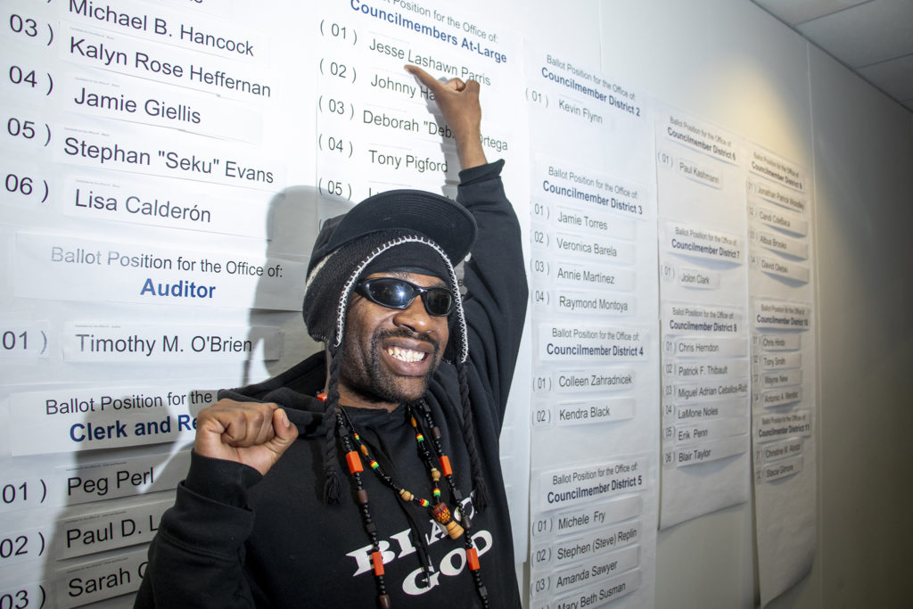 City Council At-Large candidate Jesse Paris celebrates his top-line listing on the upcoming municipal election ballot, March 14, 2019. (Kevin J. Beaty/Denverite)