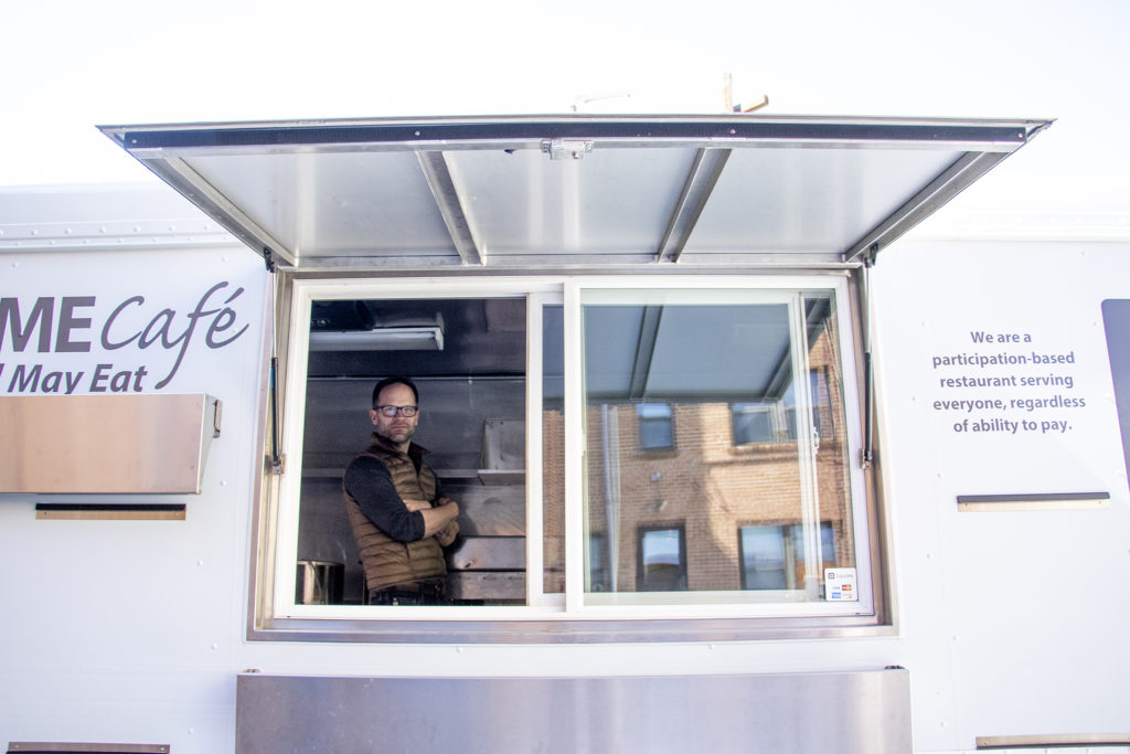 SAME Cafe Executive Director Brad Allen Reubendale poses for a portrait inside the nonprofit's new food truck, March 15, 2019. (Kevin J. Beaty/Denverite)