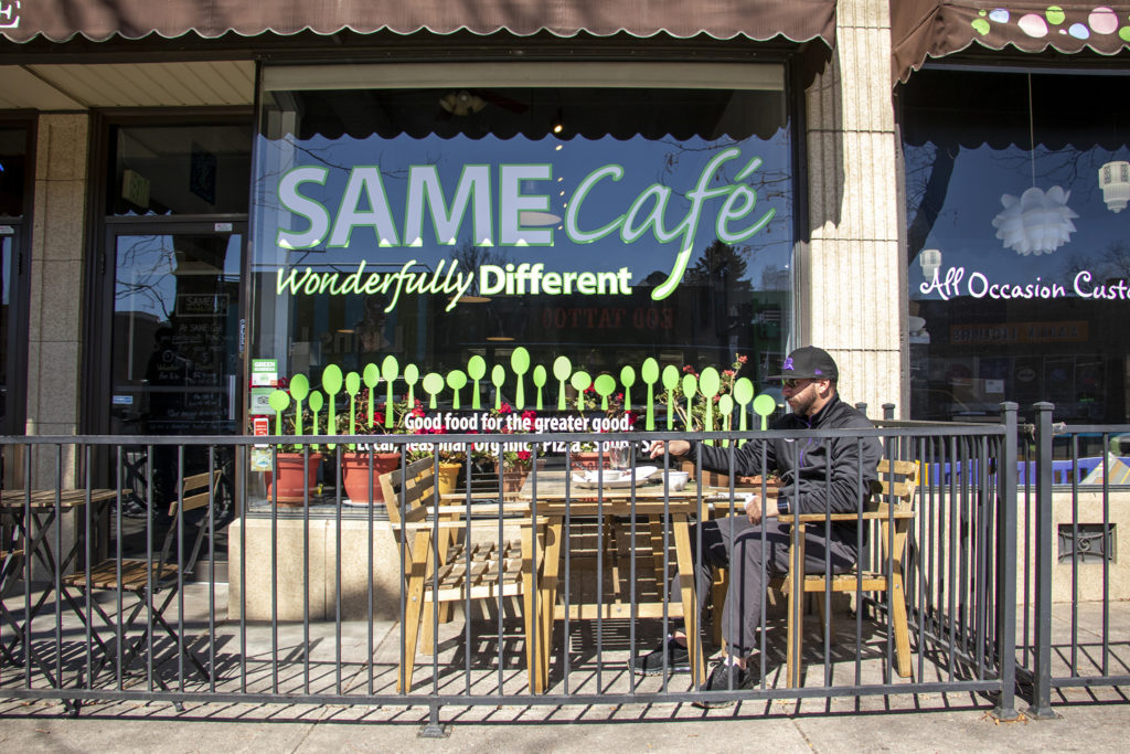Ty Maestas finishes lunch on SAME Cafe's patio, March 15, 2019. (Kevin J. Beaty/Denverite)