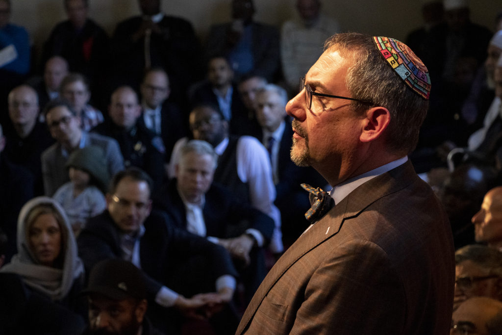 Temple Emanuel Rabbi Joseph Black listens during a vigil for the victims of a massacre at a Christchurch, New Zealand, mosque at the Colorado Muslim Society, March 16, 2019. (Kevin J. Beaty/Denverite)