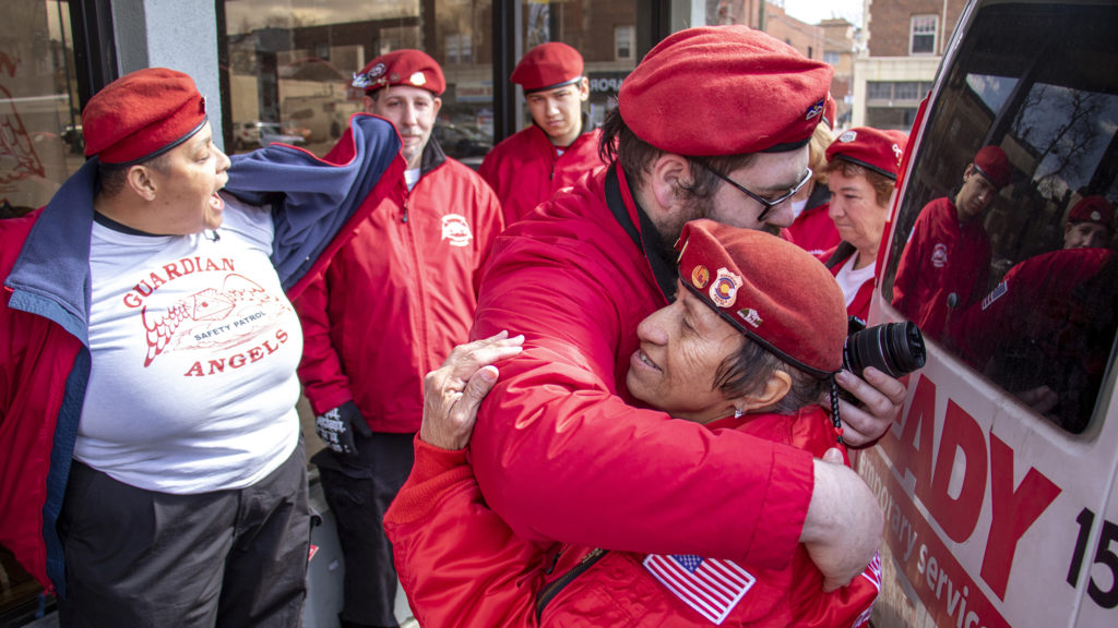 Colorado Guardian Angel Grizzly hugs Apache outside of their Colfax Avenue headquarters after she announced she'll be moving soon to Arizona, March 23, 2019. (Kevin J. Beaty/Denverite)
