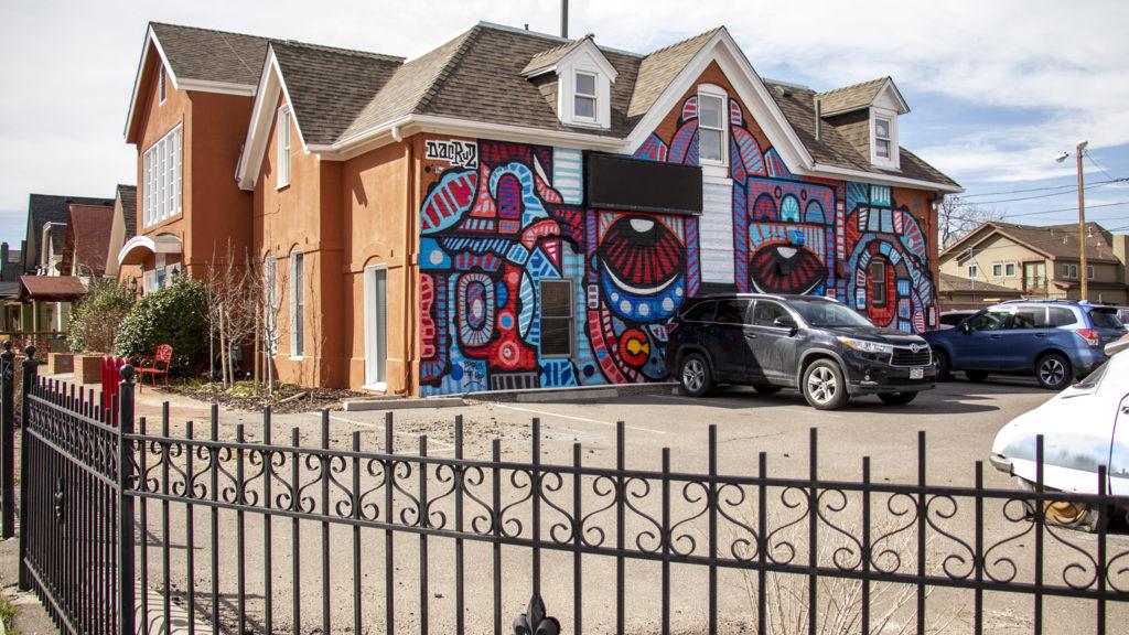 A mural by French artist Da Cruz on the Alliance Francaise de Denver building in Baker, March 26, 2019. (Kevin J. Beaty/Denverite)