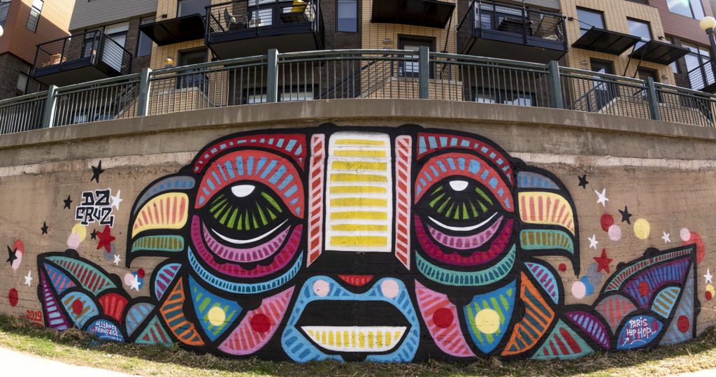 A mural by French artist Da Cruz along the Cherry Creek Trail, March 26, 2019. (Kevin J. Beaty/Denverite)