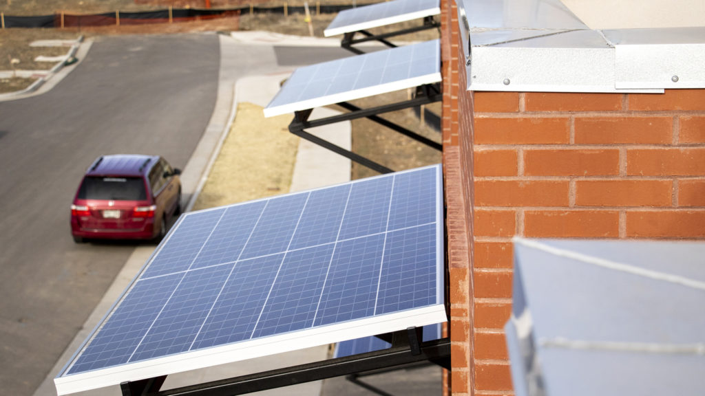 Solar panels as awnings on townhomes inside the Geos Neighborhood in Arvada, March 26, 2019. (Kevin J. Beaty/Denverite)