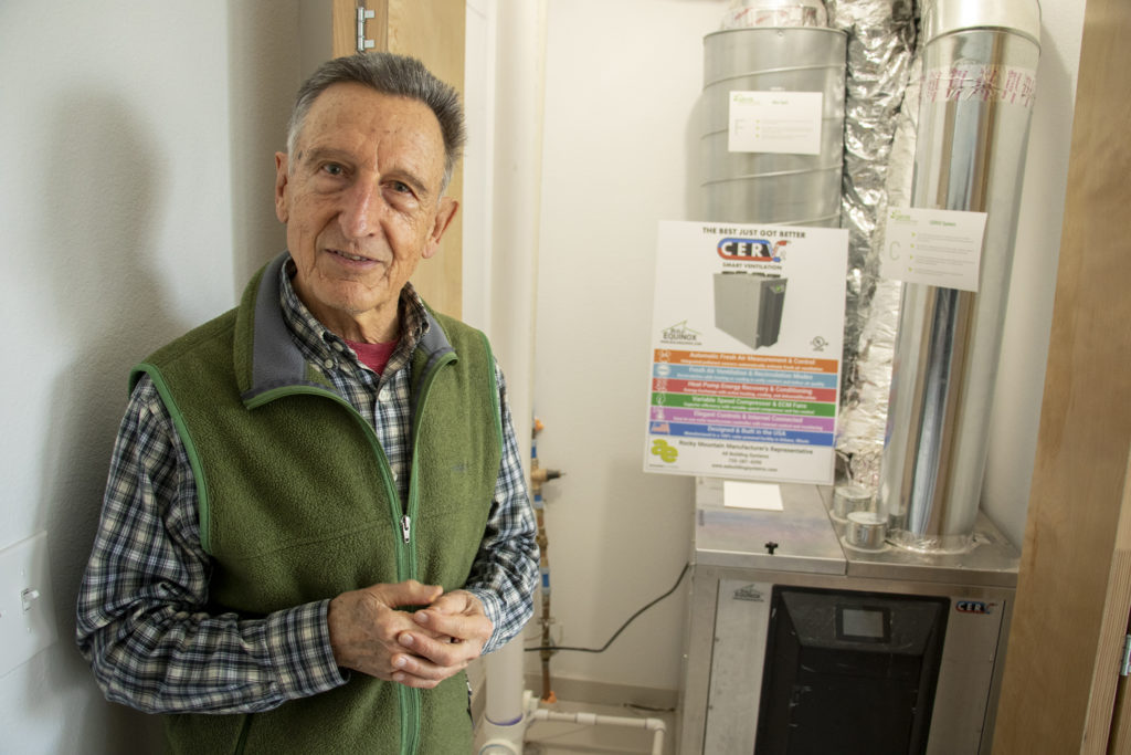 Developer Norbert Klebl shows off a temperature and air quality control system in a townhome at his Geos Neighborhood in Arvada, March 26, 2019. (Kevin J. Beaty/Denverite)