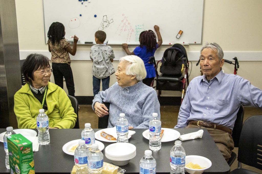 June Zhan (left to right), Chen Ping and Binhai Wei attend a healthy cooking class in the Montbello community room in the neighborhood's Save A Lot food store, March 28, 2019. (Kevin J. Beaty/Denverite)
