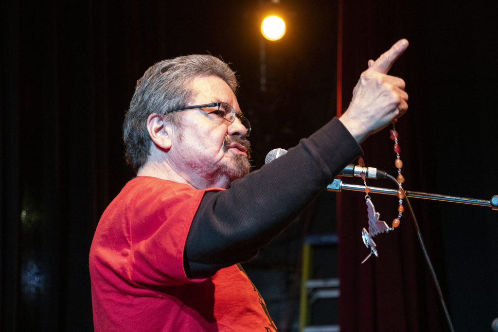 Ramon Del Castillo speaks on stage during Denver's annual Cesar Chavez Day celebration, held this year at Su Teatro on Santa Fe Drive, March 30, 2019. (Kevin J. Beaty/Denverite)
