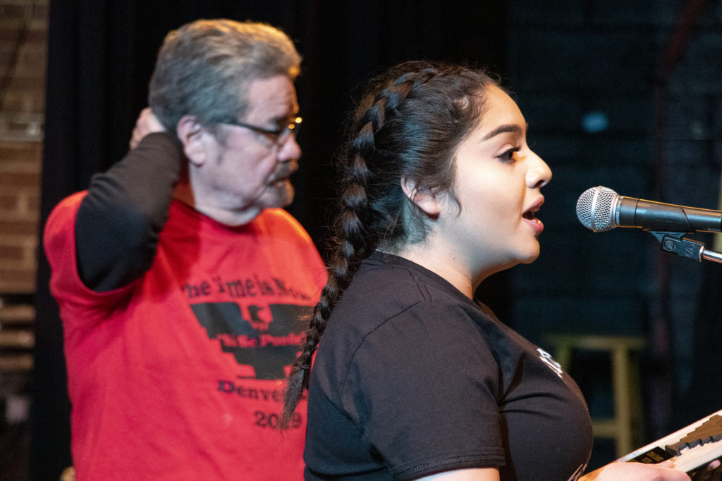 Gianella Millan accepts an award during Denver's annual Cesar Chavez Day celebration, held this year at Su Teatro on Santa Fe Drive, March 30, 2019. (Kevin J. Beaty/Denverite)