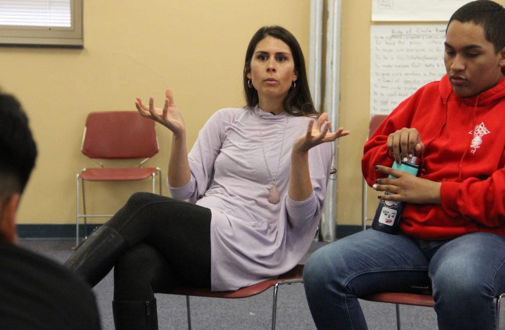 Denver Public Schools social worker Gabriela Mohr (center) during a SOMOS1 meeting on Wednesday, March 20, 2019, at Skinner Middle School in Denver. (Esteban L. Hernandez/Denverite)