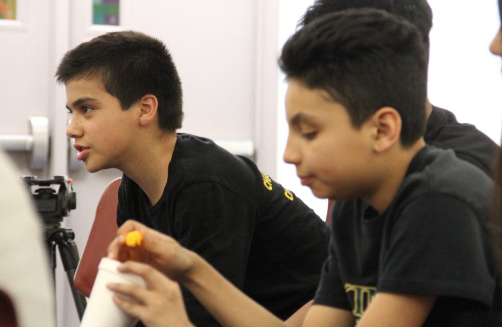 Seventh grader Victor Fierro (left) speaks during a SOMOS1 meeting on Wednesday, March 20, 2019, at Skinner Middle School in Denver. (Esteban L. Hernandez/Denverite)