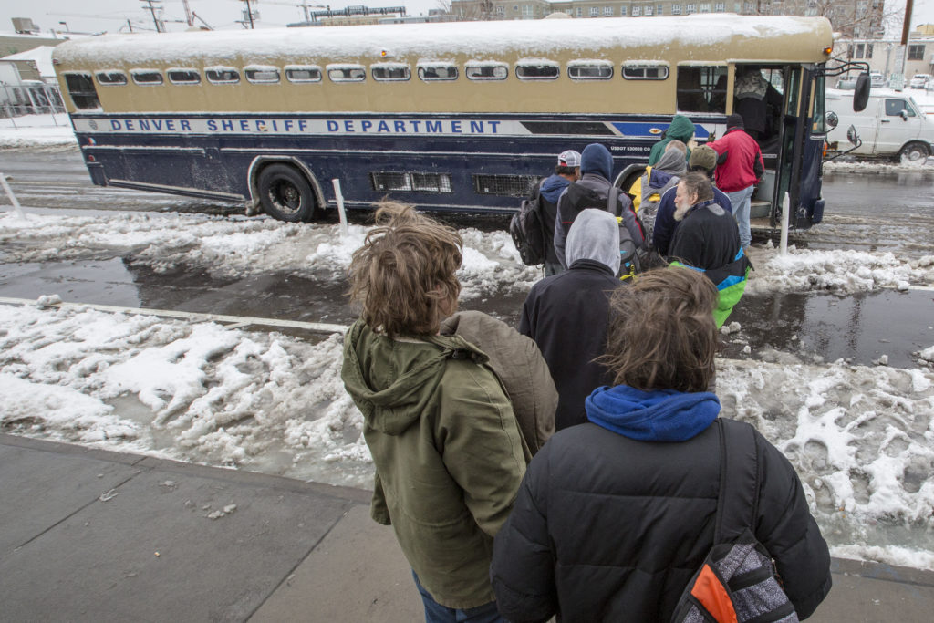 A bus headed from Lawrence Street to a Denver Rescue Mission shelter in north Denver on March 13. (Hart Van Denburg/CPR News)