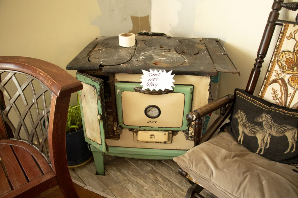 An old stove marked to be moved out of Lalo Ramirez's home in the Denver Meadows mobile home park in Aurora, March 31, 2019. (Kevin J. Beaty/Denverite)