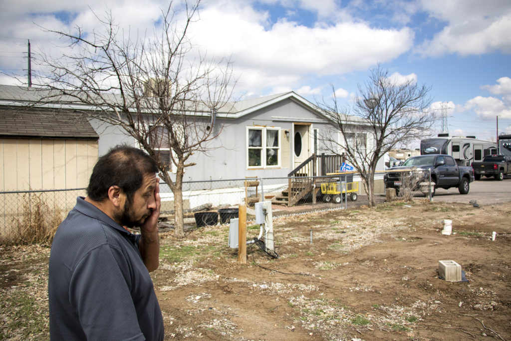 Lalo Ramirez stands in a newly vacant lot next to his home in the Denver Meadows mobile home park in Aurora, March 31, 2019. (Kevin J. Beaty/Denverite)