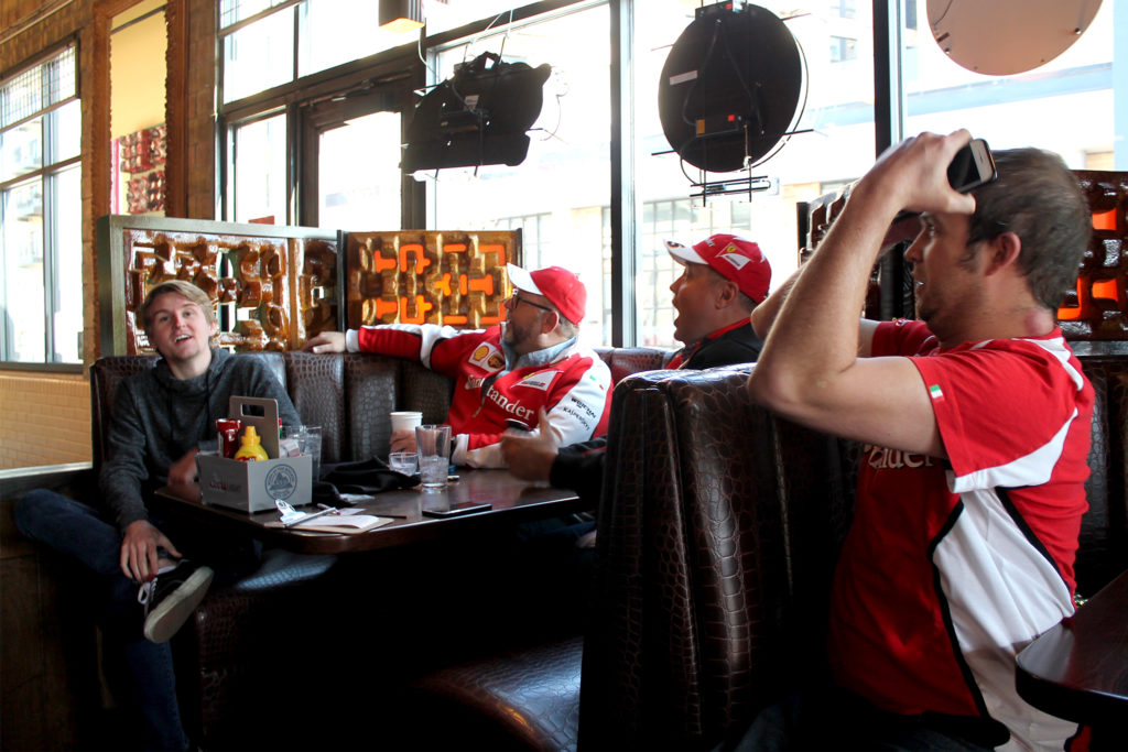 From left, Grant King, Mark Stephens, Daniel Schrader and ErikBilisoly watch a race at Will Call in River North, March 31, 2019. (David Sachs/Denverite)