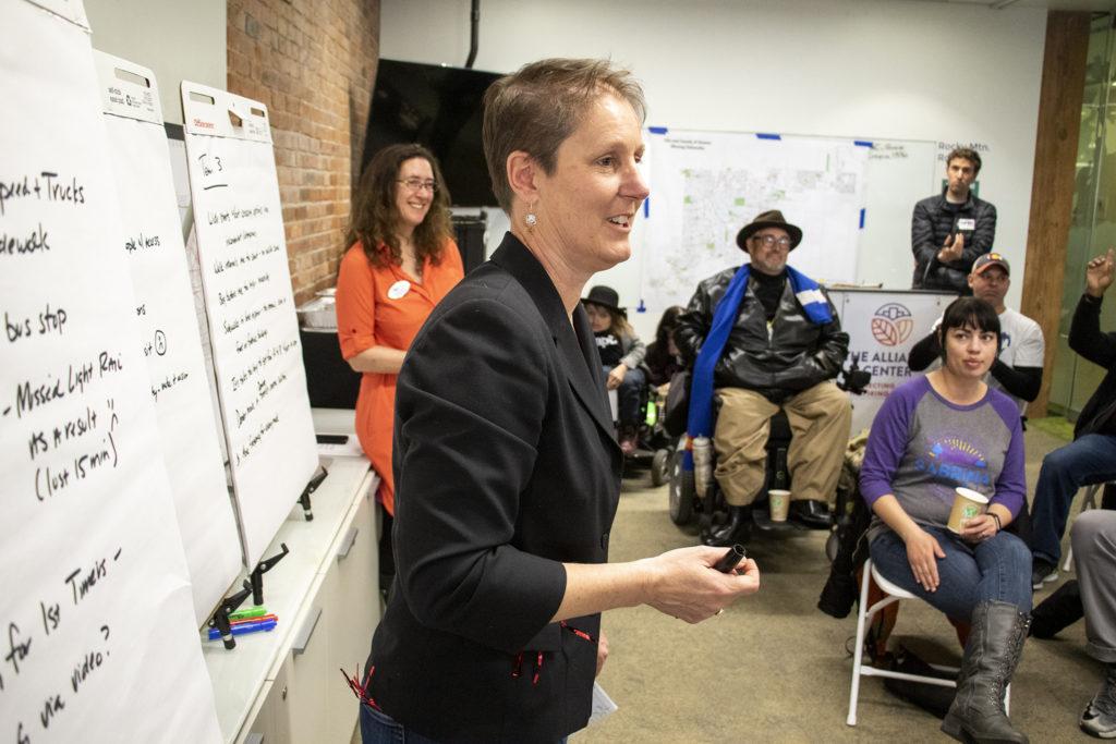 The Denver Streets Partnership chair Piep van Heuven leads a discussion after the Amazing Denver Mobility Race, April 4, 2019. (Kevin J. Beaty/Denverite)