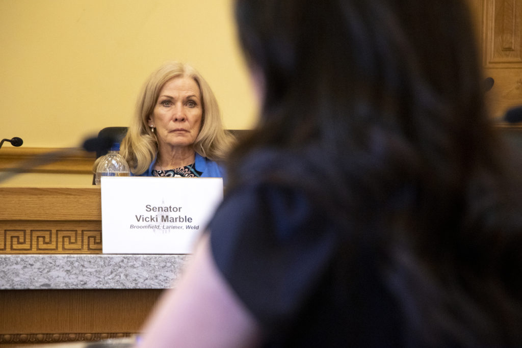 Sen. Vicki Marble listens to testimony. The Colorado Senate'sState, Veterans, & Military Affairs Committee hears testimony on SB 230, which would enshrine the state's commitment to resettling refugees in law, April 8, 2019. (Kevin J. Beaty/Denverite)