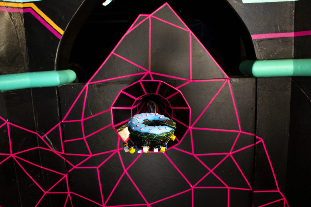A donut, representing the multiverse, on display on the way into Meow Wolf's Kaleidoscape at Elitch Gardens, April 12, 2019. (Kevin J. Beaty/Denverite)