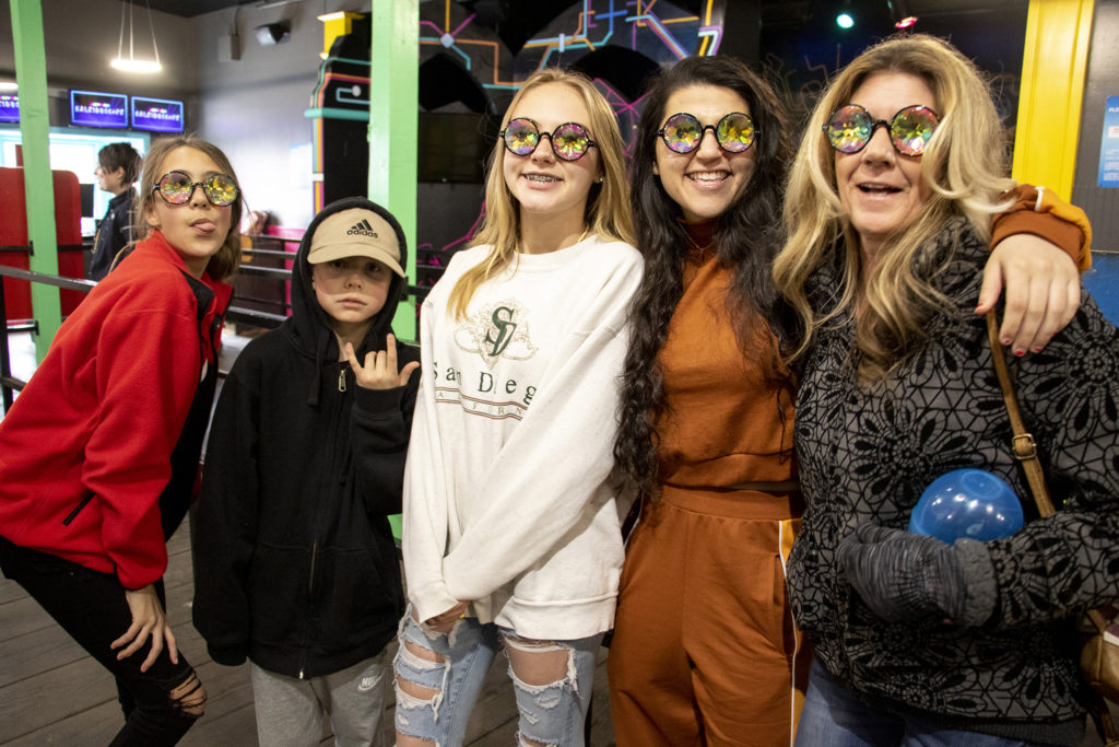 Reanna and Brody Reynolds (left to right), Sheridan Brassell, 107.5 host Rosa Jad and Heidi Reynolds pose for a portrait outside of Meow Wolf's Kaleidoscape attraction at Elitch Gardens, April 12, 2019. (Kevin J. Beaty/Denverite)