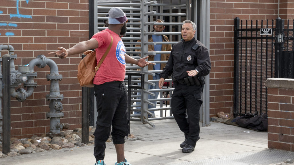 A man named Jeremiah argues with police as the Denver Department of Public Health and Environment cleans up sidewalks near the Denver Rescue Mission, April 17, 2019. (Kevin J. Beaty/Denverite)