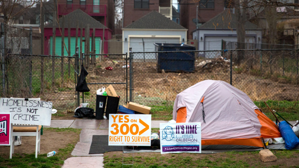 Tents at a homeless camp on Arapahoe at 27th in Denver, with new homes in the background on April 10, 2019. (Hart Van Denburg/CPR News)