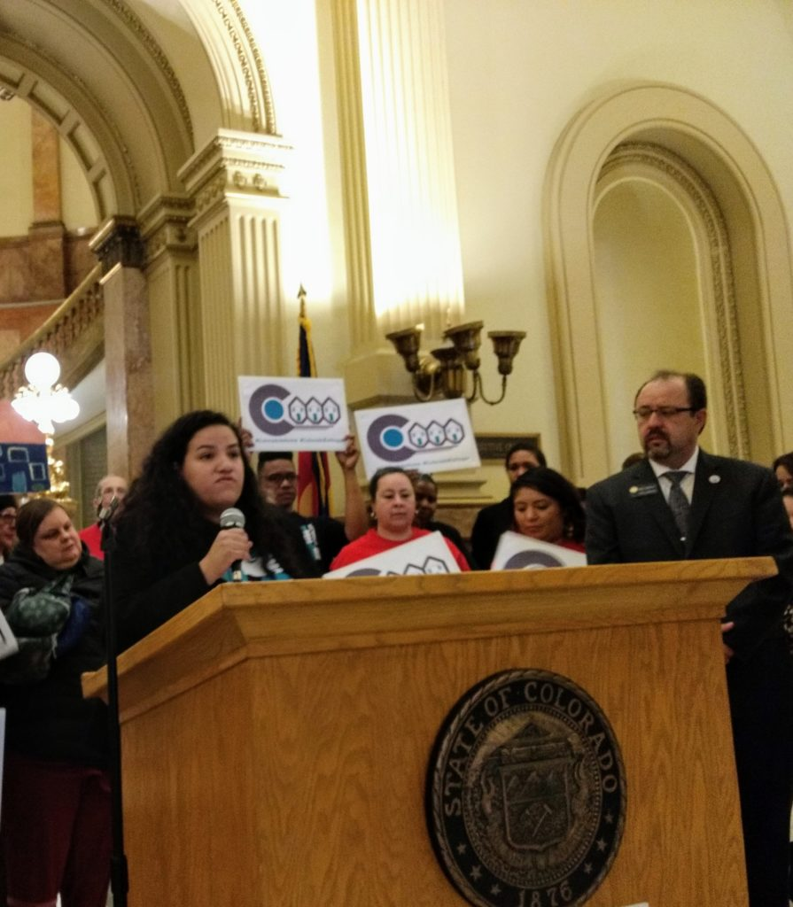 Celesté Martinez, UNE organizing director, speaks at the Capitol during a news conference by supporters of a bill to allow rent control in Colorado. April 9, 2019. (Donna Bryson/Denverite)