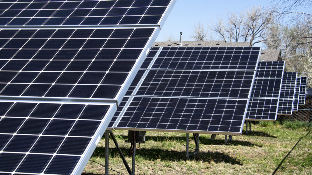 A solar array behind the Fruitdale School apartments, Wheat Ridge, May 2, 2019. (Kevin J. Beaty/Denverite)