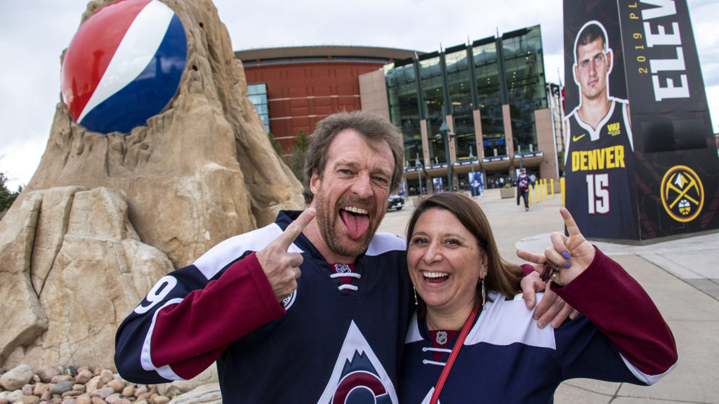 Leslie and Richard Foust, who drove up from Albuquerque to watch the Avalanche game, pose for a portrait outside of the Pepsi Center, May 2, 2019. (Kevin J. Beaty/Denverite)