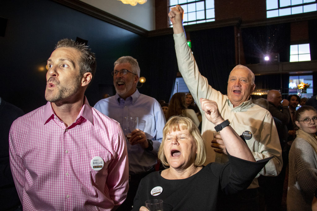 The crowd cheers as election data is updated live at mayoral candidate Jamie Giellis' watch party in RiNo, May 7, 2019. (Kevin J. Beaty/Denverite)