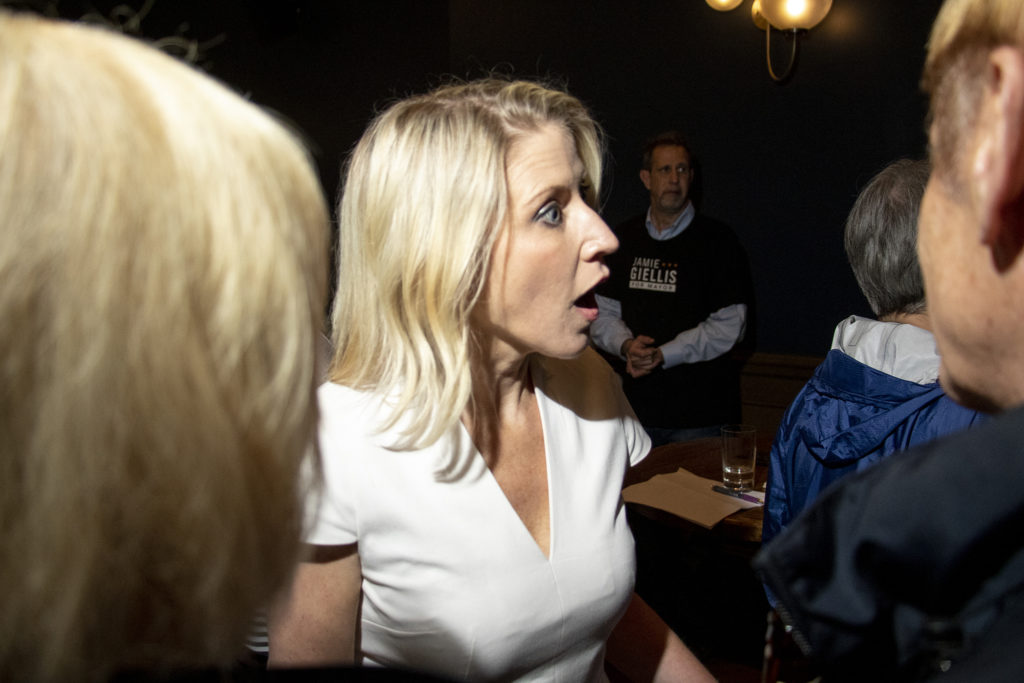 Mayoral candidate Jamie Giellis reacts to news that Mayor Michael Hancock congratulated her on making the runoff election at her watch party in RiNo, May 7, 2019. (Kevin J. Beaty/Denverite)