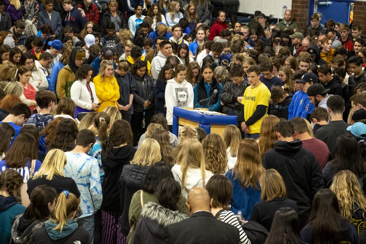 STEM School Highlands Ranch students take turns at the microphone at a vigil at Highlands Ranch High School on Wed., May 8, 2019. (Kevin J. Beaty/Denverite)
