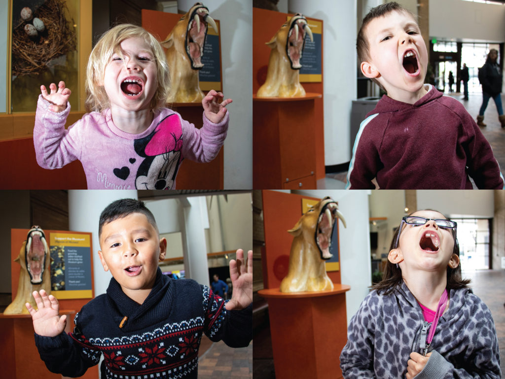 Kids roar for the camera inside the Denver Museum of Nature and Science, May 9, 2019. (Kevin J. Beaty/Denverite)