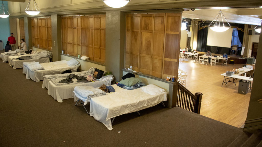 Cots arranged for migrants sleeping at Denver Community Church as they make their way to friends and family across the U.S. May 13, 2019. (Kevin J. Beaty/Denverite)