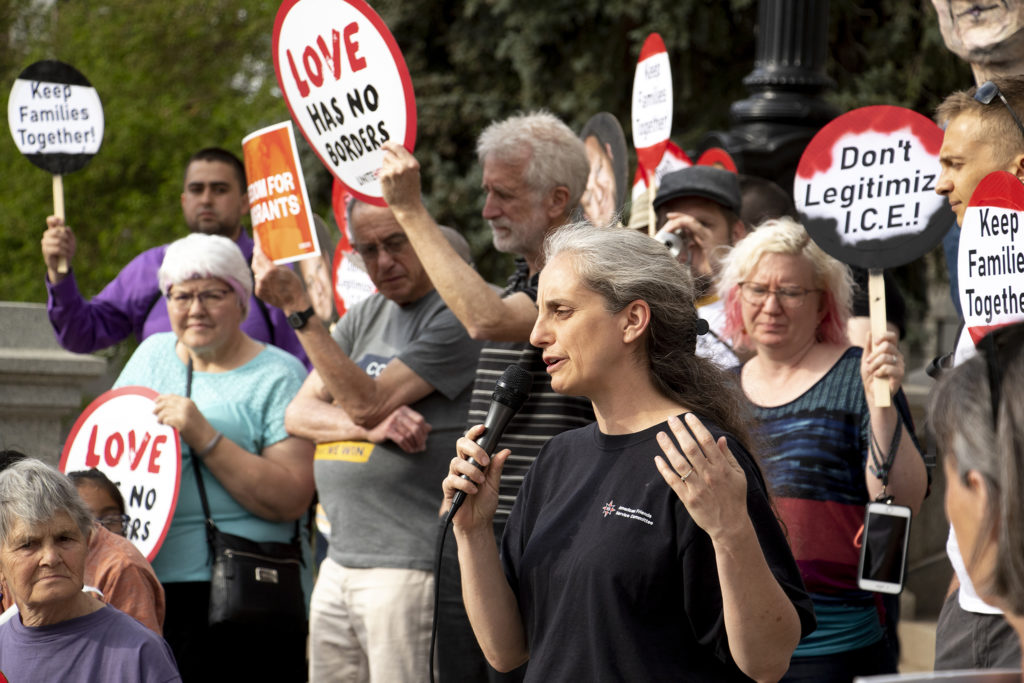 Jennifer Piper leads a rally calling for Gov. Jared Polis to support immigrants, May 13, 2019. (Kevin J. Beaty/Denverite)