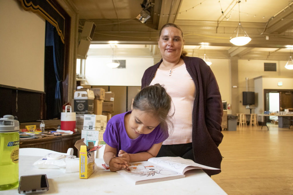 Maria Jeanette poses for a portrait with her daughter, Faviola. Denver Community Church of Christ, May 14, 2019. (Kevin J. Beaty/Denverite)